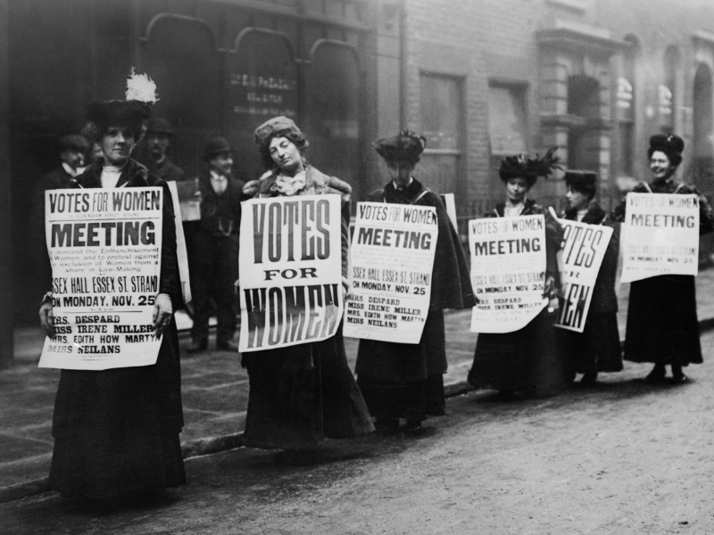 Suffragettes marching for women's rights